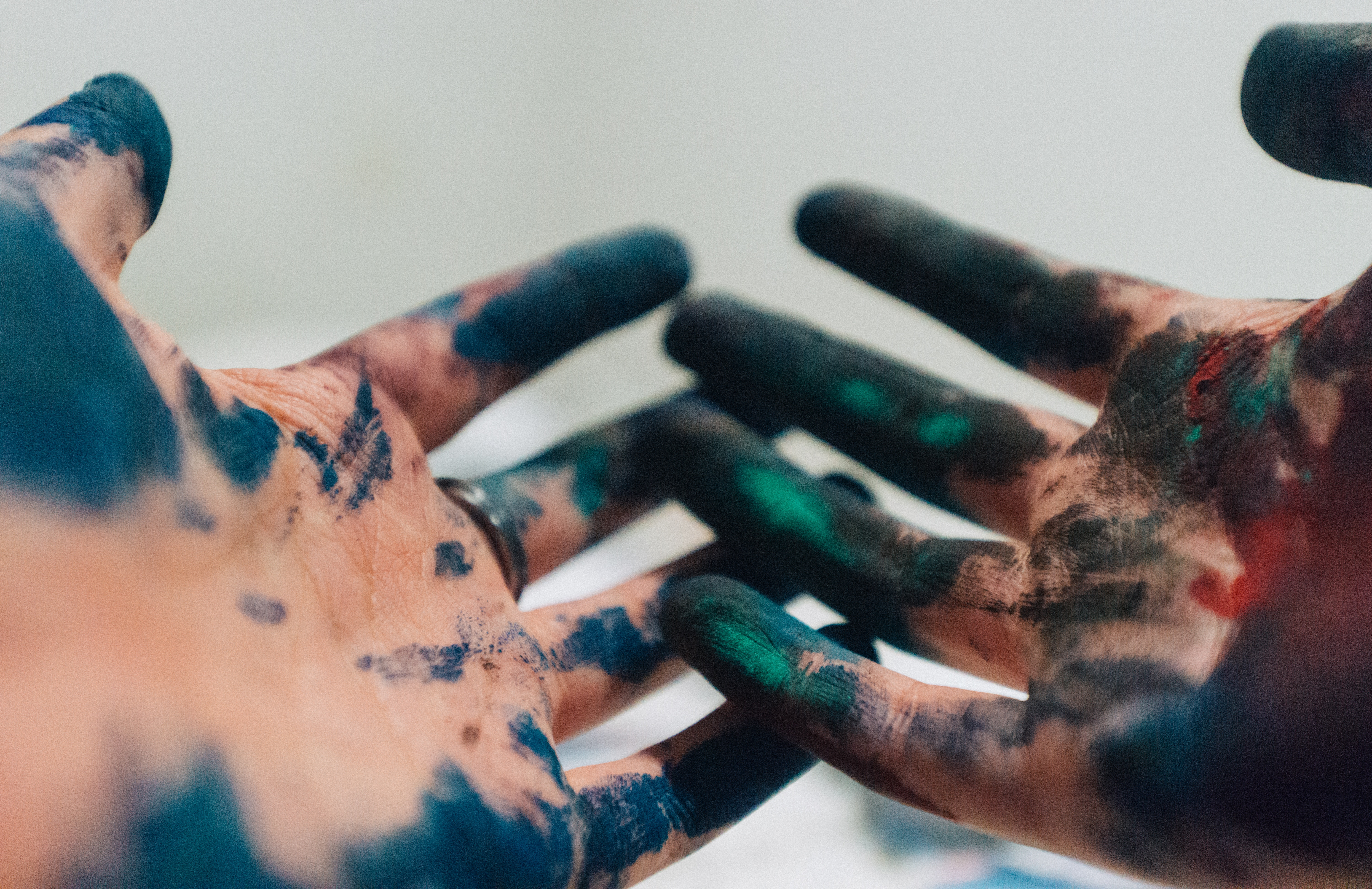hands covered in paint