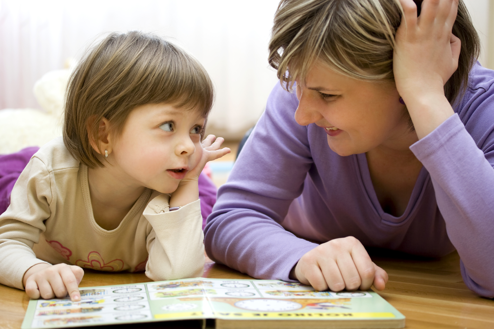 image of a child reading with an adult