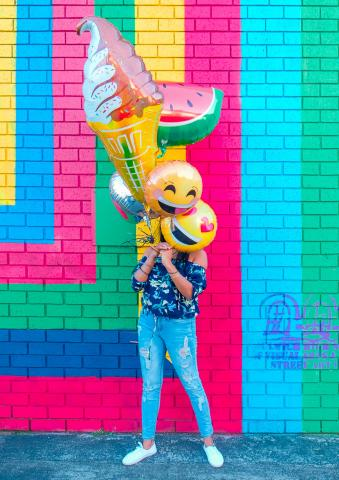 woman with emoji balloons